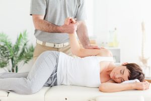 stoke chiropractor giving adjustment